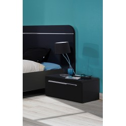 First - black gloss bedside cabinets