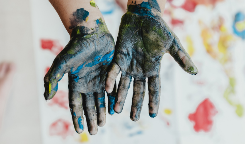 children's hands stained with paint