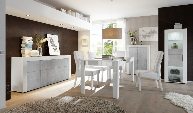 A bright dining room with white dining table and chairs and two sideboards