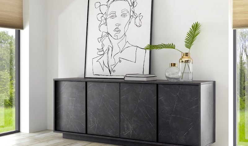 big black sideboard with a one-line painting on top