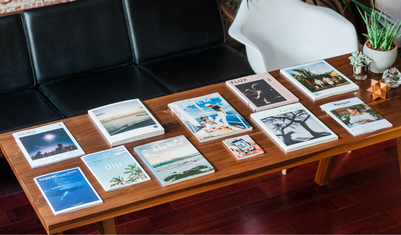 magazines on brown wooden coffee table