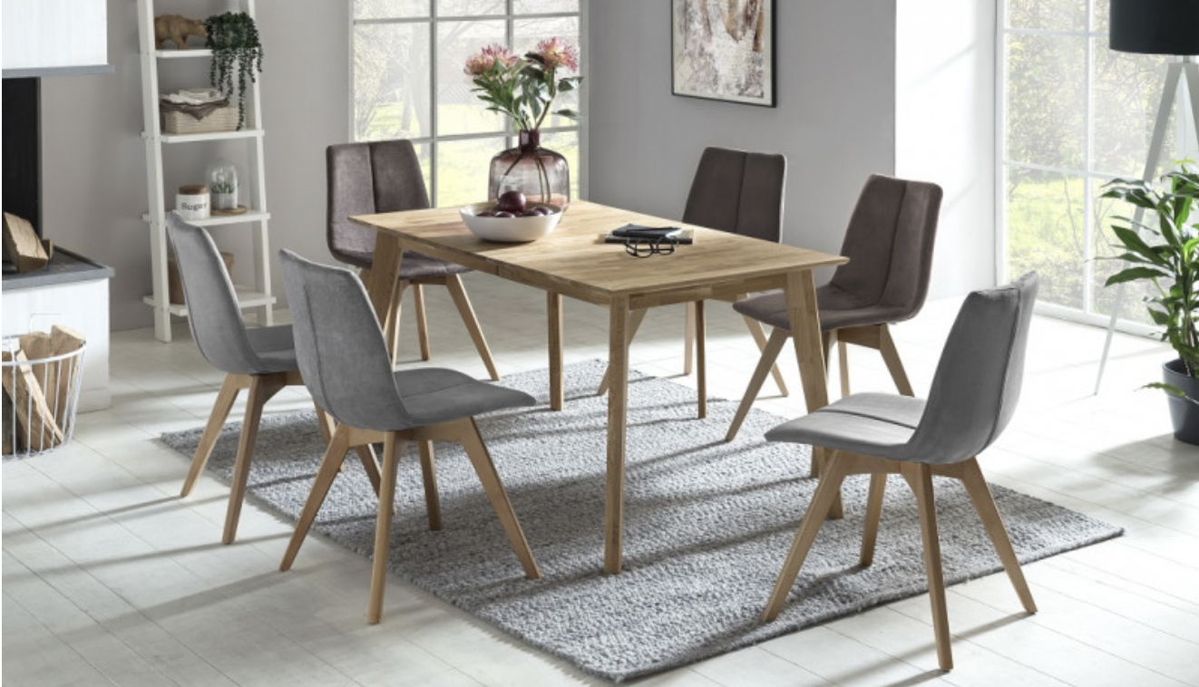 a wooden dining table with 6 upholstered wooden chairs