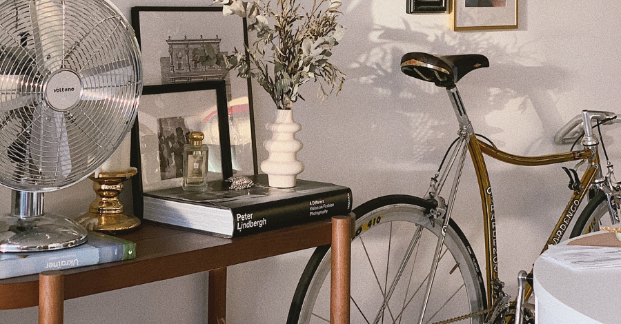 a bike beside the table with books