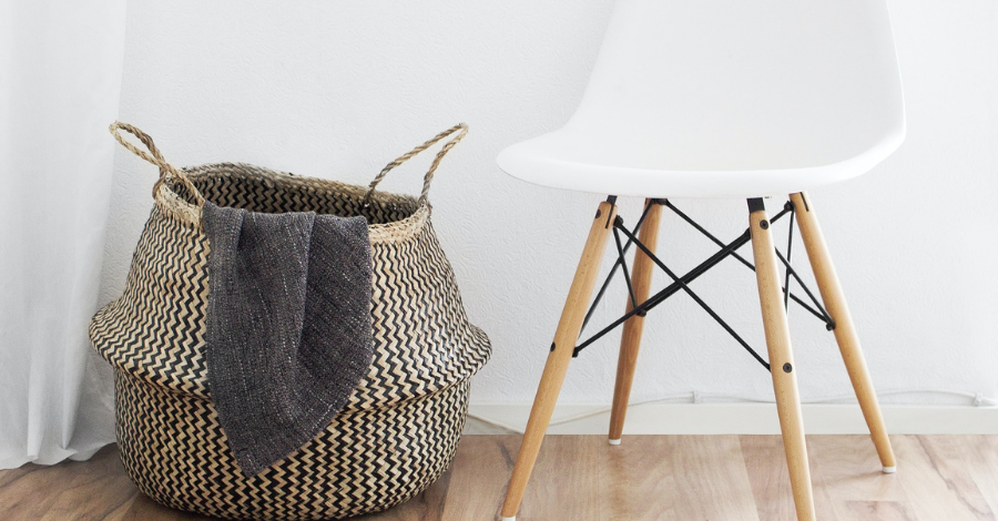 a basket and a white chair