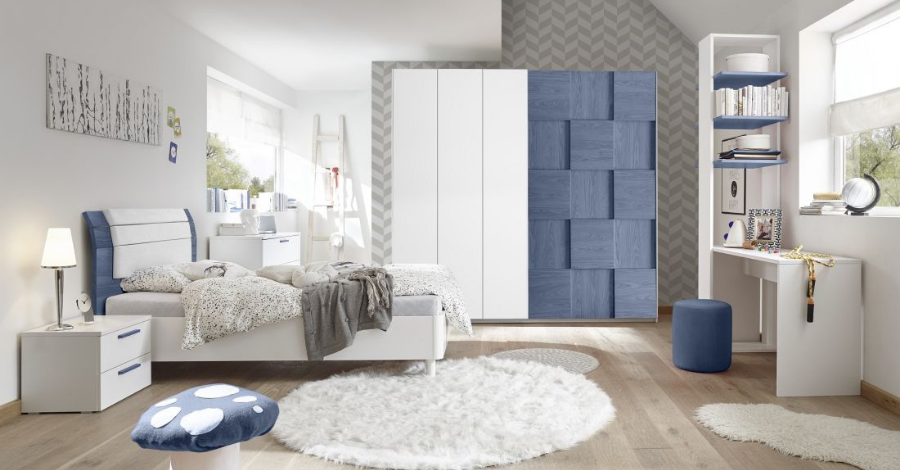 a white and blue wardrobe behind a bed