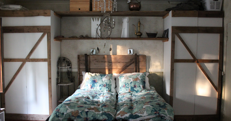 a bed with a wooden headboard