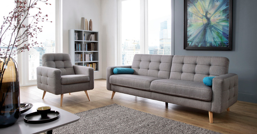 a grey double sofa and an armchair in the living room