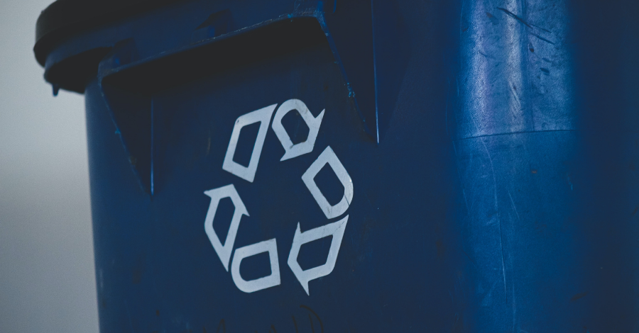 Recycling logo on a blue container