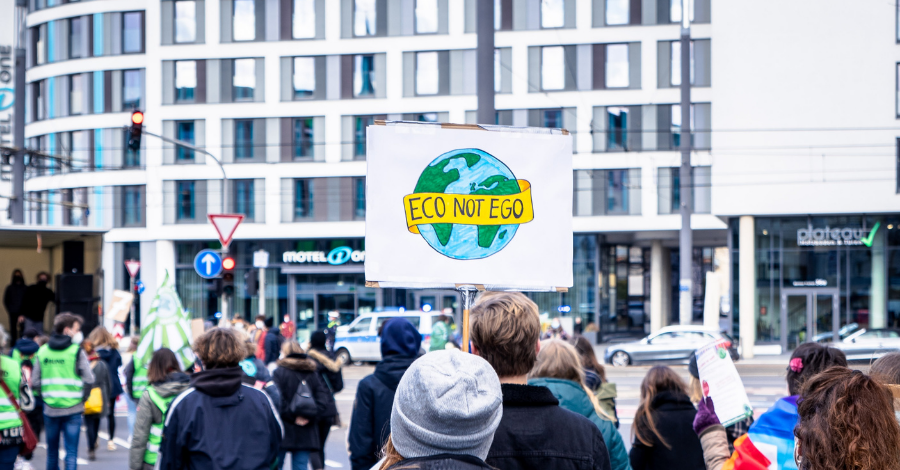 eco not ego banner carried by a protester