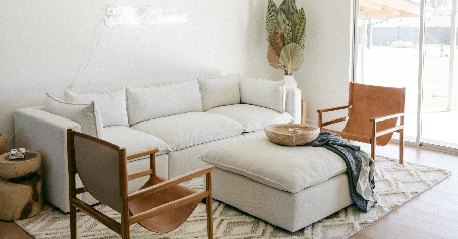 white sofa and wooden brown armchairs
