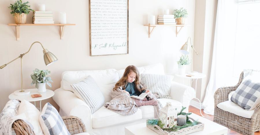 a kid on a white sofa